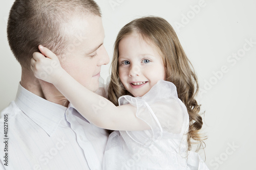 Portrait of beautiful smiling family: father and daughter