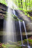 Fototapety sunbeam over the waterfall in the forest