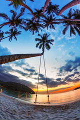 Swing on  sunset at the beach