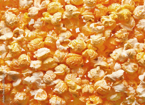 Salted popcorn grains against white background