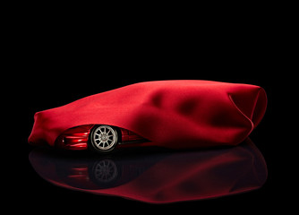 new car hidden under red cover