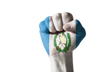 Fist painted in colors of guatemala flag