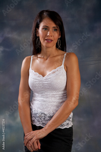 Pretty woman in white blouse looking thoughtfully at the camera