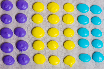 Purple yellow and blue candy dots