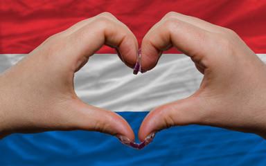 over national flag of netherlands showed heart and love gesture