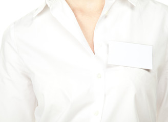 Blank badge attached to the shirt of woman