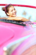 Retro woman happy in old vintage car