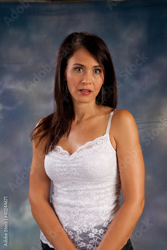 Pretty dark haired woman looking at camera