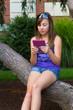 Girl Outside with Digital Reader