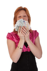 Beautiful young woman with money isolated on white background