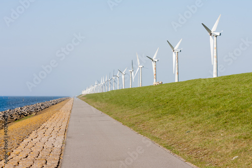 Wind turbines along a Dutch dike