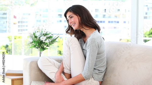 Woman laughing indoors
