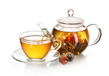 Fototapety exotic green tea with flowers in glass teapot and cup isolated