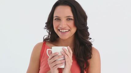 Girls sniffs her cup