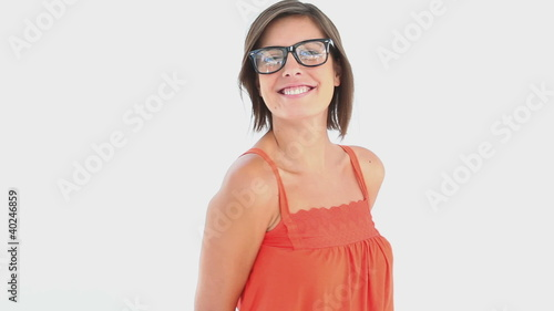A woman wears large glasses