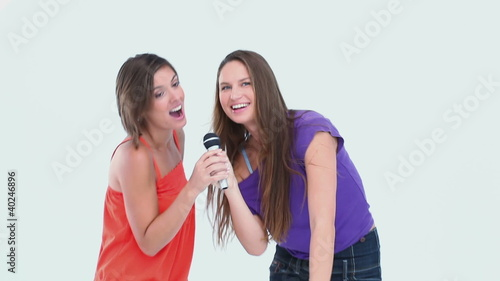 Friends singing at karaoke