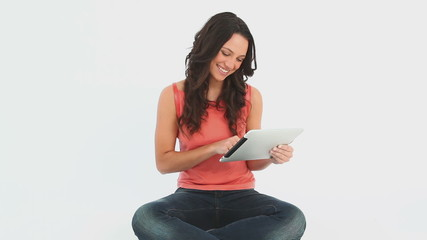 Young Woman uses her tablet
