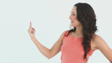 A lady raising her hand to point with her finger