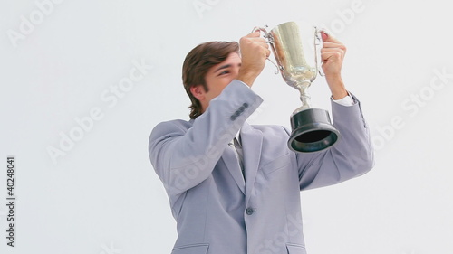 Smiling man holding a trophy