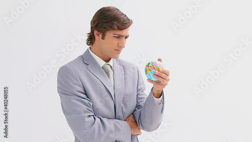 Businessman holding a small globe