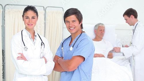 Doctors standing while crossing their arms