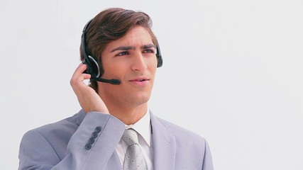 Handsome businessman talking on a headset