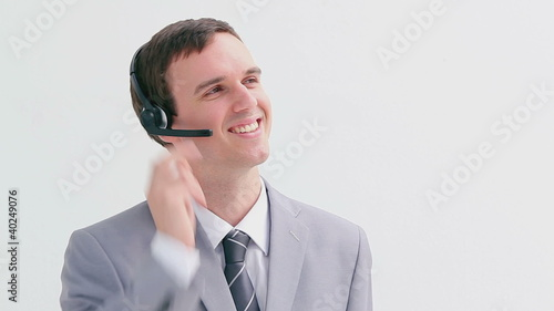 Smiling call centre agent talking into his headset