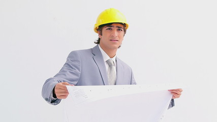 Serious businessman checking the construction work