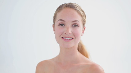 Smiling blonde woman turning her head