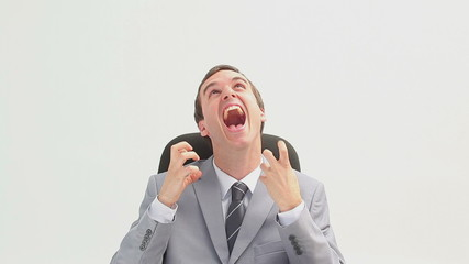 Businessman sitting making facial expressions