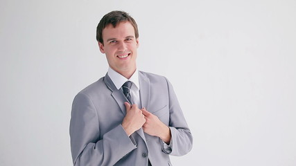 Smiling businessman wearing his jacket