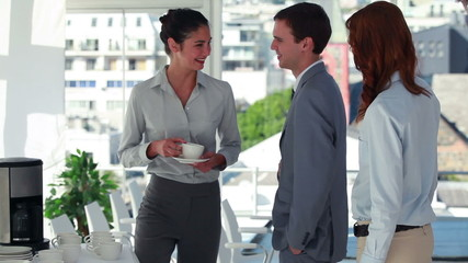 Woman drinking a cup of coffee before shaking hands