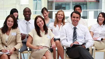 Front view of smiling business people