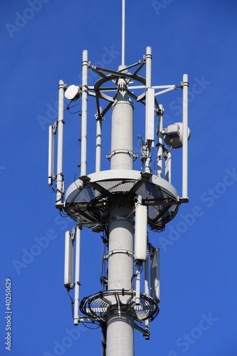 Cell tower and radio antenna.