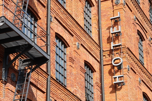Hotel sign. Historic factory building style.