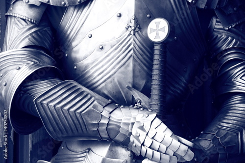 Ancient metal armor in sepia.