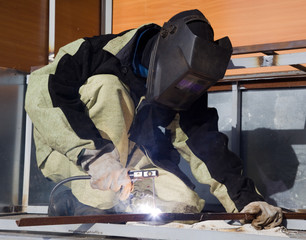 Welder in a special suit while working