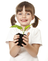 happy little girl with plant in her hand - environmental concept
