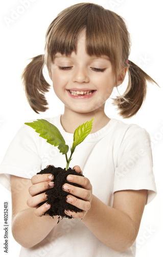 happy little girl with plant in her hand - grow concept