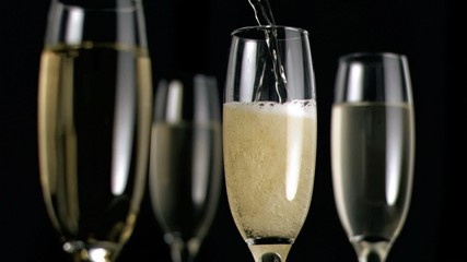 Champagne flowing in super slow motion