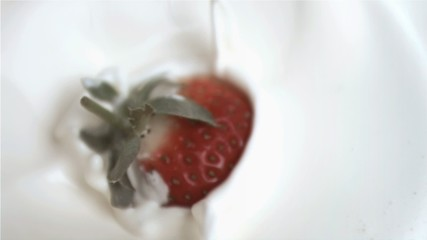 Strawberry falling in super slow motion