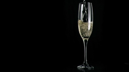 White champagne poured in super slow motion