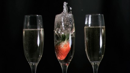 Strawberry diving in super slow motion in champagne