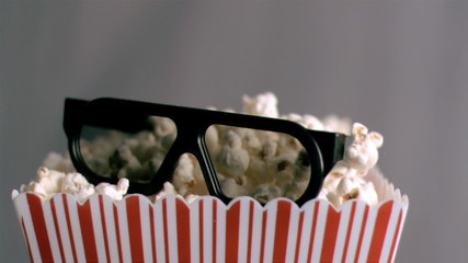 3D glasses falling in super slow motion