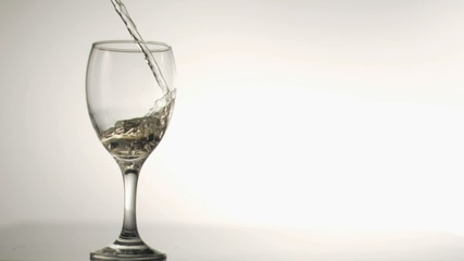 Liquid flowing in super slow motion in a glass