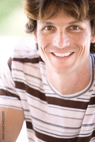 Young man smiling, close-up, portrait