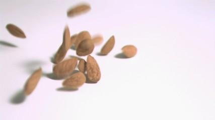 Almonds falling in super slow motion