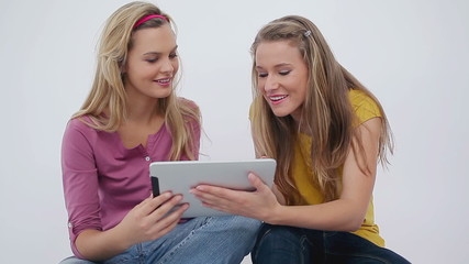 Women sitting while using an ebook