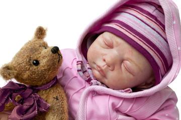 Little girl sleeps with teddy bear
