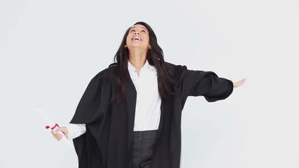 Happy graduated student throwing her cap